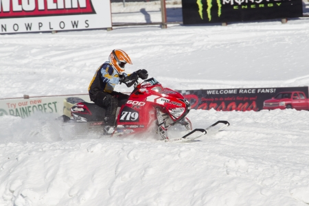 polaris: EAGLE RIVER, WI - MARCH 2:  Red and Black Polaris Snowmobile during a race on March 2, 2013 in Eagle River, Wisconsin.