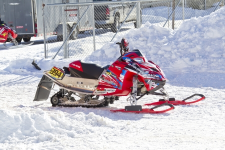 polaris: EAGLE RIVER, WI - MARCH 2:  Red and Black Polaris Snowmobile After the Race on March 2, 2013 in Eagle River, Wisconsin. Editorial