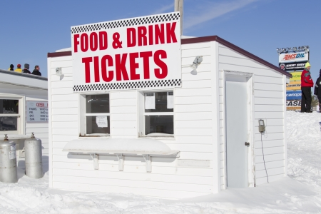 concession: EAGLE RIVER, WI - MARCH 2:  Food and Drink Concession and Ticket Stand at the Snowmobile Races on March 2, 2013 in Eagle River, Wisconsin.