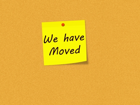 we have moved: We have Moved on Yellow Sticky note on Corkboard making a great concept