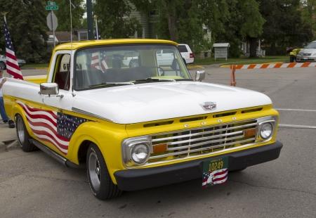 WINNECONNE, WI - JUNE 1:  1970s Yellow U.S. Flag Ford Truck at Annual Car Show on Main Street June 1, 2013 in Winneconne, Wisconsin.