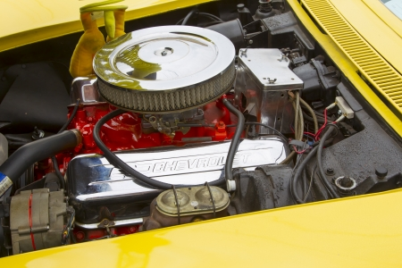 WINNECONNE, WI - JUNE 1:  Engine of a Yellow 1968 Chevy Corvette Roadster car at Annual Car Show on Main Street June 1, 2013 in Winneconne, Wisconsin.