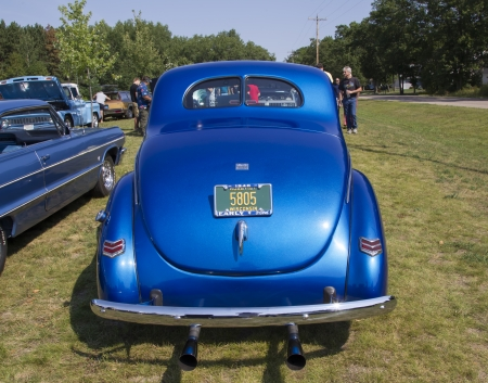 WAUPACA, WI - AUGUST 24:  Back of a 1940 Blue Ford Deluxe Car at Waupaca Rod and Classic Car Show August 24, 2013 in Waupaca, Wisconsin.