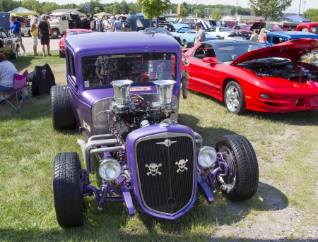 purple car: WAUPACA, WI - AUGUST 24:  Front of purple 1932 Chevy Roadster Car at Waupaca Rod and Classic Car Show August 24, 2013 in Waupaca, Wisconsin.