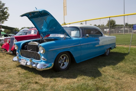 bel air: WAUPACA, WI - AUGUST 24:  Side of 1955 Blue and White Chevy Bel Air Car at Waupaca Rod and Classic Annual Car Show August 24, 2013 in Waupaca, Wisconsin.