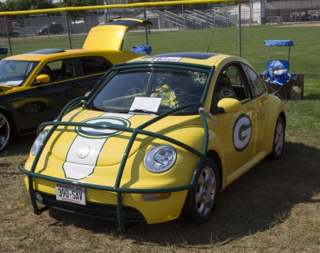 vw: WAUPACA, WI - AUGUST 24:  Side of 2002 Green Bay Packers VW Beetle Car at Waupaca Rod and Classic Annual Car Show August 24, 2013 in Waupaca, Wisconsin.