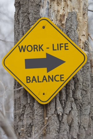 life balance: Work Life Balance This Way Sign on a tree in the woods making a great concept. Stock Photo