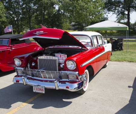 WAUPACA, WI - AUGUST 24:  A red and white1956 Chevy Bel Air car at Waupaca Rod and Classic Annual Car Show August 24, 2013 in Waupaca, Wisconsin.