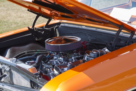 waupaca: WAUPACA, WI - AUGUST 24:  Engine of 1966 Orange Chevy El Camino car at Waupaca Rod and Classic Annual Car Show August 24, 2013 in Waupaca, Wisconsin.