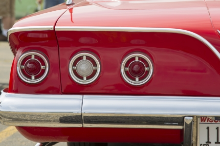 IOLA, WI - JULY 13:  Tail lights of 1961 Red Chevy Impala car at Iola 41st Annual Car Show July 13, 2013 in Iola, Wisconsin.