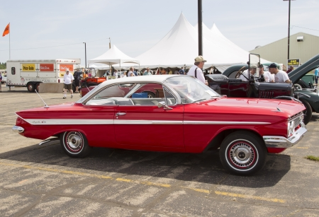 IOLA, WI - JULY 13:  Side of 1961 Red Chevy Impala car at Iola 41st Annual Car Show July 13, 2013 in Iola, Wisconsin.