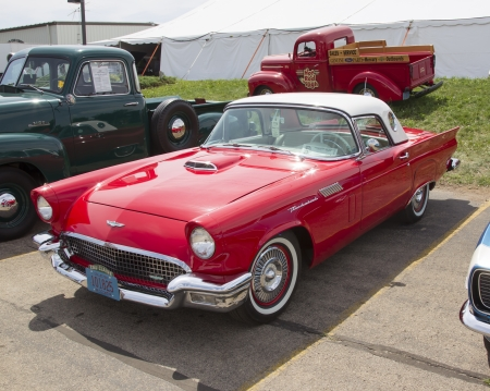 thunderbird: IOLA, WI - JULY 13:  1957 Red Ford Thunderbird car at Iola 41st Annual Car Show July 13, 2013 in Iola, Wisconsin.