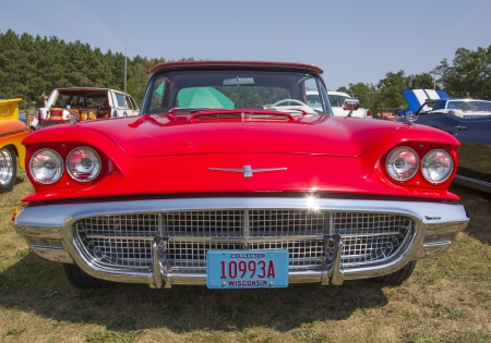 WAUPACA, WI - AUGUST 24:  1960 Red Ford Thunderbird Car at Waupaca Rod and Classic Annual Car Show August 24, 2013 in Waupaca, Wisconsin. Editorial