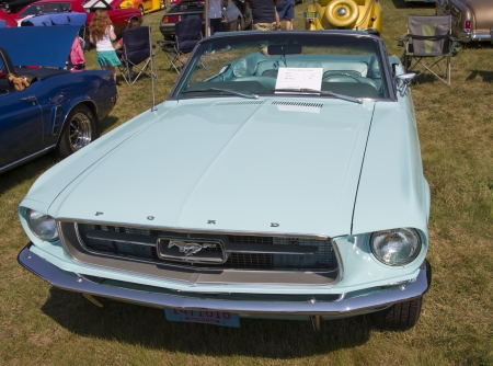 WAUPACA, WI - AUGUST 24:  1967 Aqua Blue Ford Mustang Convertible Car at Waupaca Rod and Classic Annual Car Show August 24, 2013 in Waupaca, Wisconsin.