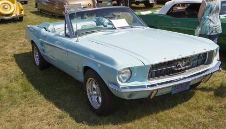 WAUPACA, WI - AUGUST 24:  Side of 1967 Aqua Blue Ford Mustang Convertible Car at Waupaca Rod and Classic Annual Car Show August 24, 2013 in Waupaca, Wisconsin.