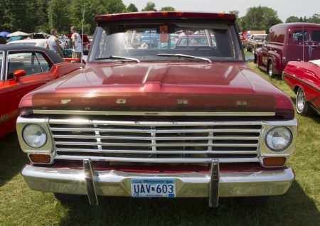 IOLA, WI - JULY 13:  Front of Vintage Red Ford F100 Pickup Truck at Iola 41st Annual Car Show July 13, 2013 in Iola, Wisconsin.