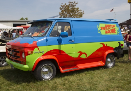 IOLA, WI - JULY 13:  Side of 1974 Chevy Scooby Doo Mystery Machine Van at Iola 41st Annual Car Show July 13, 2013 in Iola, Wisconsin.