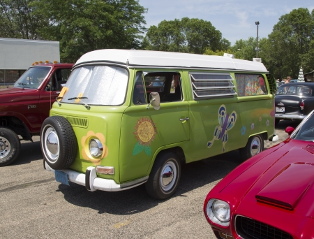 IOLA, WI - JULY 13:  Side of 1968 VW Hippie Camper Special Van at Iola 41st Annual Car Show July 13, 2013 in Iola, Wisconsin.
