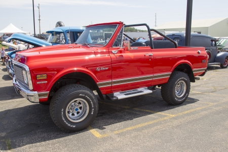 IOLA, WI - JULY 13:  Red Chevy K5 Blazer at Iola 41st Annual Car Show July 13, 2013 in Iola, Wisconsin.