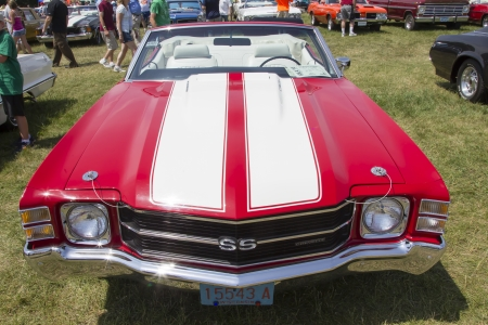 chevy: IOLA, WI - JULY 13:  Front of 1971 Red with white stripes Chevy Chevelle SS Car at Iola 41st Annual Car Show July 13, 2013 in Iola, Wisconsin. Editorial