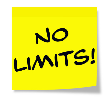 limits: No Limits written on a yellow Sticky Note making a great concept. Stock Photo