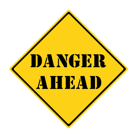 danger: A yellow and black diamond shaped road sign with the words DANGER AHEAD making a great concept.