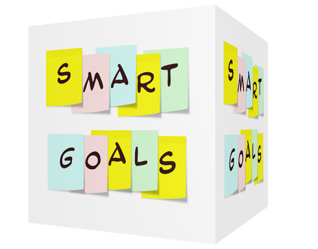 Smart Goals written on colorful sticky notes on a 3D cube photo