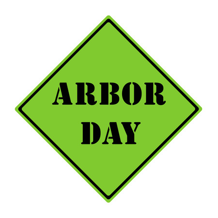 A green and black diamond shaped road sign with the words ARBOR DAY making a great concept.