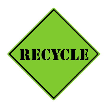 A green and black diamond shaped road sign with the word RECYCLE making a great concept. Stock Photo