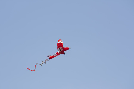OSHKOSH, WI - JUNE 20:  A Red Baron plane kite fly high in the sky at the Kite Festival June 20, 2009 in Oshkosh, Wisconsin.