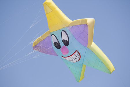 OSHKOSH, WI - JUNE 20:  Close up of a colorful custom star kite fly high in the sky at the Kite Festival June 20, 2009 in Oshkosh, Wisconsin.