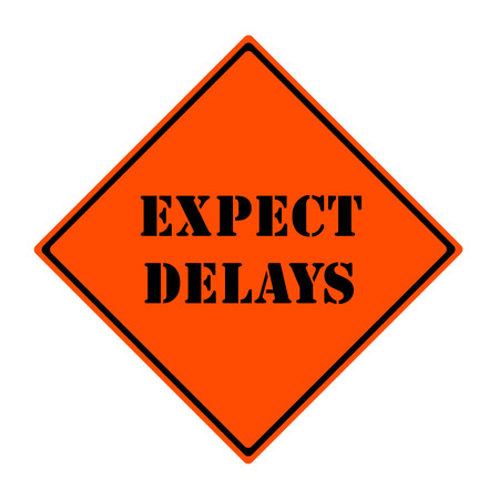 delays: An orange and black diamond shaped road sign with the words EXPECT DELAYS making a great concept.