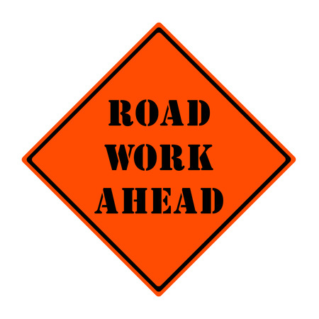 An orange and black diamond shaped road sign with the words ROAD WORK AHEAD making a great concept.