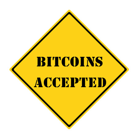 A yellow and black diamond shaped road sign with the words BITCOINS ACCEPTED making a great concept.