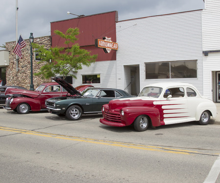 WINNECONNE, WI - JUNE 1:  Parked street view of Vintage Red and White Ford Coupe Car at Annual Car Show on Main Street June 1, 2013 in Winneconne, Wisconsin.