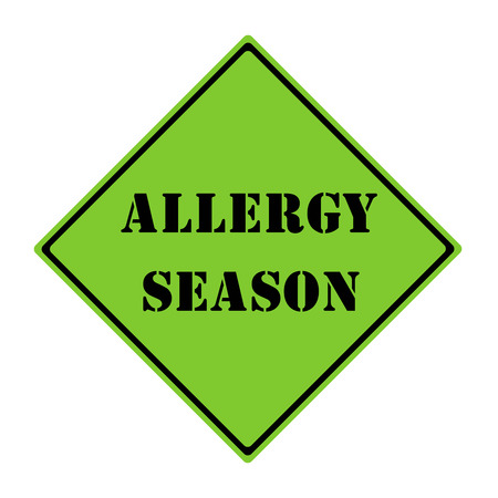 A green and black diamond shaped road sign with the words ALLERGY SEASON making a great concept.