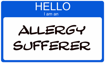 allergies: Hello I am an Allergy Sufferer on a blue and white name tag sticker. Stock Photo