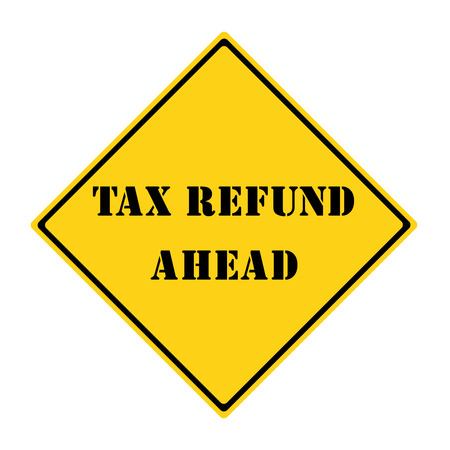 A yellow and black diamond shaped road sign with the words TAX REFUND AHEAD making a great concept. Stock Photo