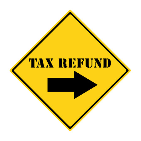 A yellow and black diamond shaped road sign with the words TAX REFUND and an arrow pointing the way making a great concept. Stock Photo
