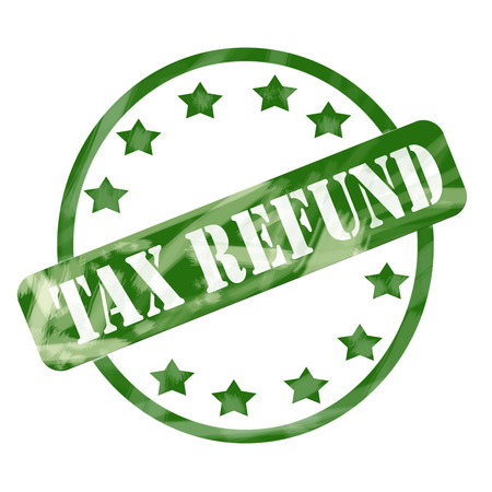 A green ink weathered roughed up circle and stars stamp design with the words TAX REFUND on it making a great concept. Stock Photo