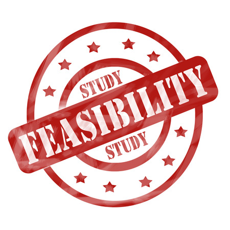 feasibility: A red ink weathered roughed up circles and stars stamp design with the words FEASIBILITY STUDY on it making a great concept. Stock Photo