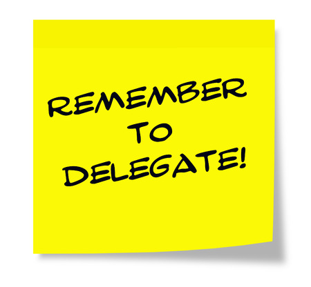 delegate: Remember to Delegate written on a sticky note making a great concept.