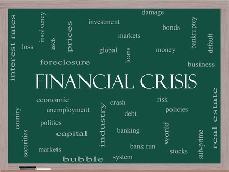 Financial Crisis Word Cloud Concept on a Blackboard with great terms such as global, crash, risk and more. photo