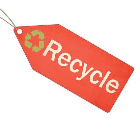 A red, green and white textured Recycle Red Tag and String making a great concept. photo