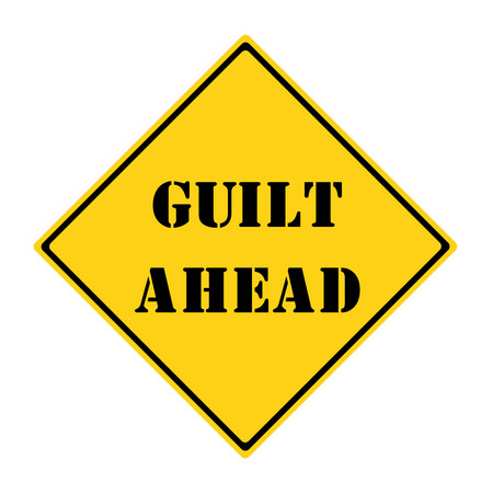 A yellow and black diamond shaped road sign with the words GUILT AHEAD making a great concept.