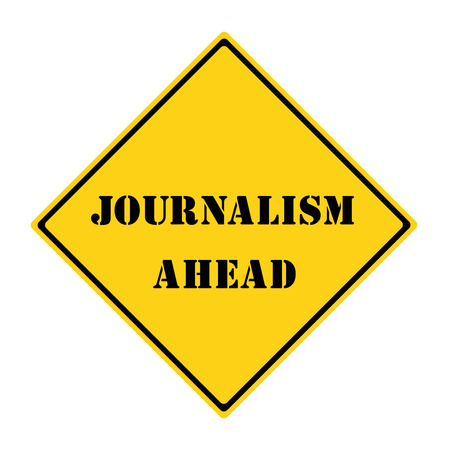 A yellow and black diamond shaped road sign with the words JOURNALISM AHEAD making a great concept.