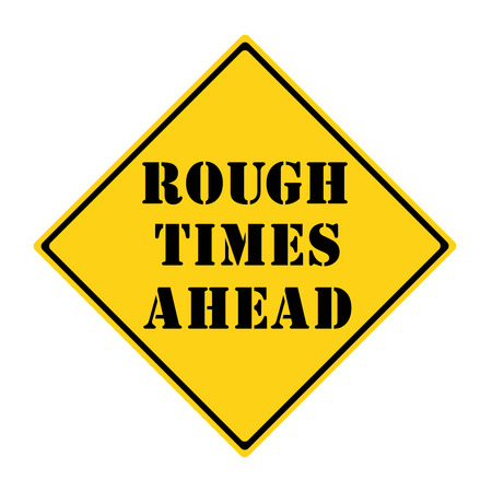 rough road: A yellow and black diamond shaped road sign with the words ROUGH TIMES AHEAD making a great concept. Stock Photo
