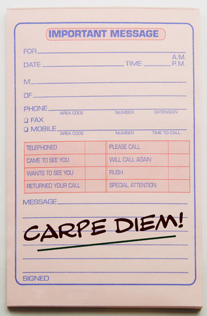 important: Carpe Diem written on a pink important message pad making a great concept.