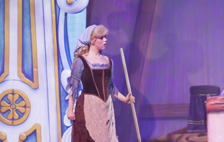 GREEN BAY, WI - FEBRUARY 10:  Cinderella with broom from Cinderella at the Disney Princesses show at the Resch Center on February 10, 2012 in Green Bay, Wisconsin. Publikacyjne