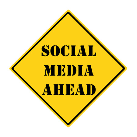 A yellow and black diamond shaped road sign with the words SOCIAL MEDIA AHEAD making a great concept. Stock Photo